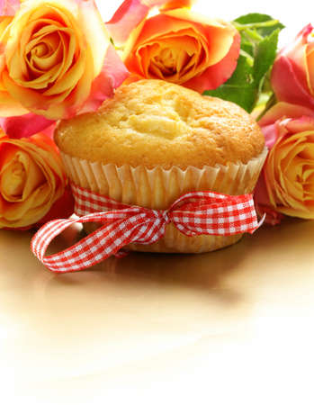 cake muffin with a bouquet of roses photo