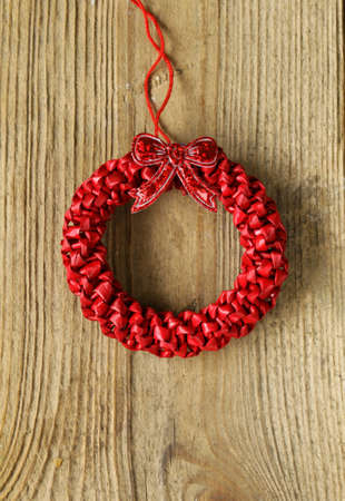 Festive red Christmas wreath on a wooden background photo