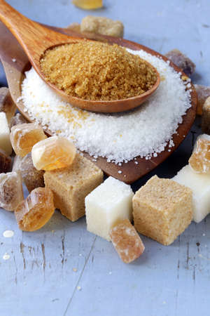 Various kinds of sugar, brown, white and refined sugar photo