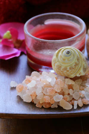 pink salt, candle and towel - spa concept photo