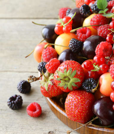 berry assortment - raspberries, blackberries, strawberries, currants, cherries photo