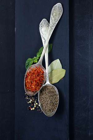 spice saffron and cumin in a vintage spoons photo