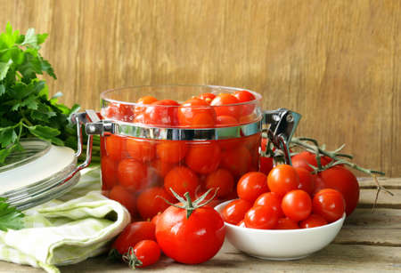 snack tomatoes pickled with herbs and spices photo