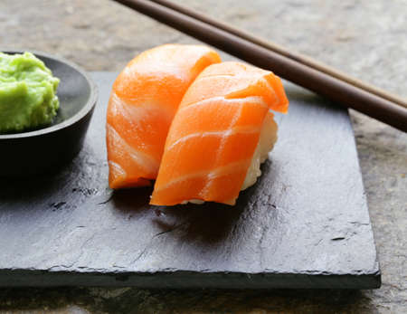 sushi with salmon - traditional Japanese food photo