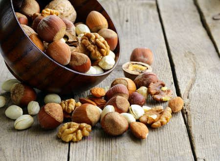 mixed nuts: Mix nuts  almonds, hazelnuts, walnuts  on a wooden table Stock Photo