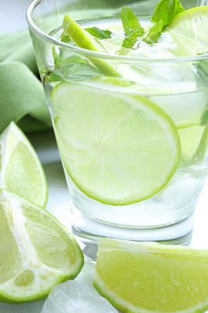 Mojito cocktail with lime, mint and ice photo