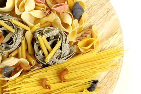 different kinds of pasta  spaghetti, fusilli, penne, linguine  photo