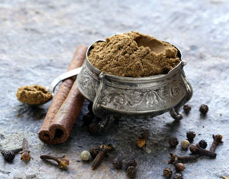 Indian mix of ground spices garam masala photo