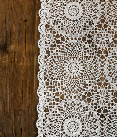 white lace: wooden background with white lace napkin Stock Photo