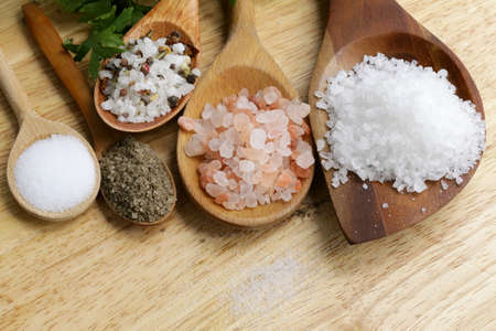 different types of salt  pink, sea, black, and with spices  Stock Photo