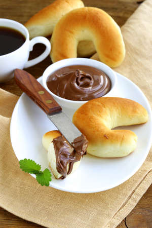 Chocolate nut paste for breakfast with bread rolls photo