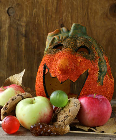 Halloween pumpkin Jack O Lantern with fruit and sweets Stock Photo