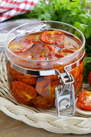 sundried: sun-dried tomatoes with herbs and olive oil in the pot