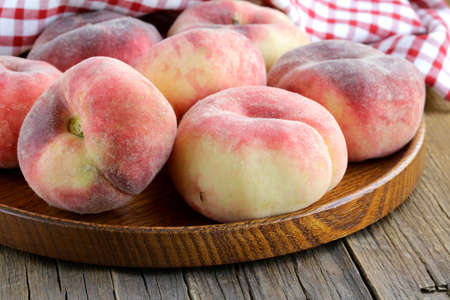fig peaches sweet and ripe on a wooden table