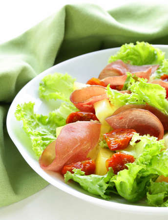 fresh green snack salad with ham and vegetables