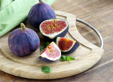 Fresh ripe purple figs whole and sliced photo
