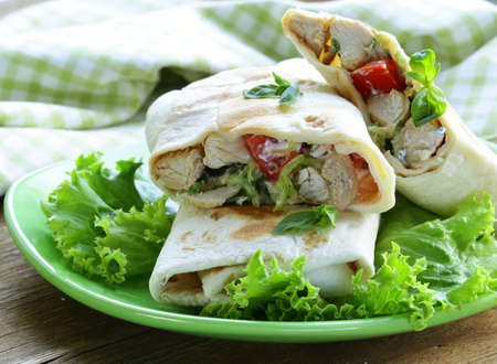 burrito  doner  with chicken and vegetables wrapped in pita bread