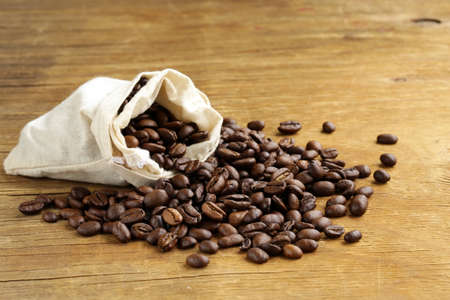 roasted coffee beans on a wooden table photo