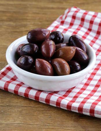 kalamata: ripe black kalamata olives in a white bowl