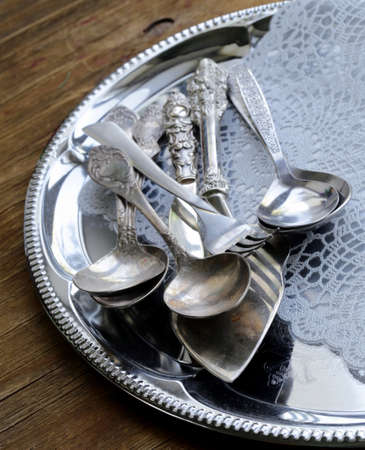 vintage cutlery with old-fashioned napkin on a silver tray photo