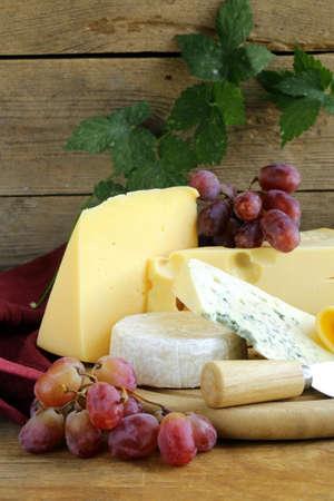 cheeseboard: cheeseboard  Maasdam, Roquefort, Camembert  and grapes for dessert