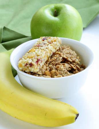 granola bar, green apple and banana - healthy eating photo