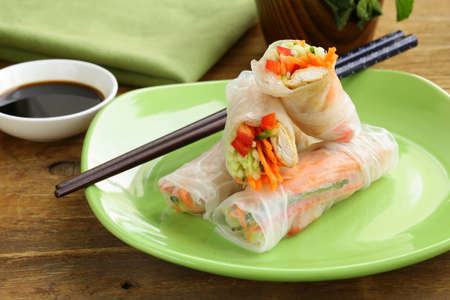 spring roll: spring rolls with vegetables and chicken on a plate