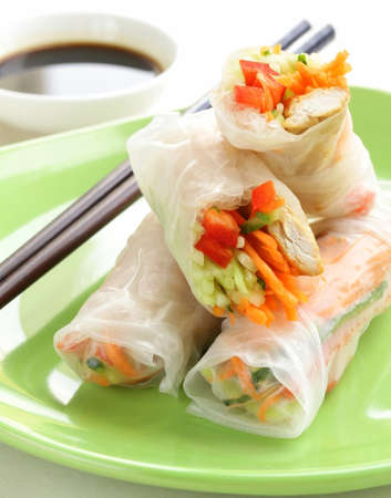 cuon: spring rolls with vegetables and chicken on a plate