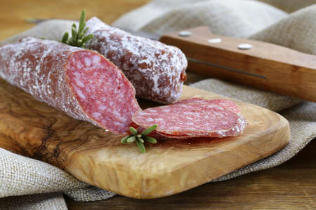 delicacy smoked sausage  pepperoni  on a cutting board Stock Photo