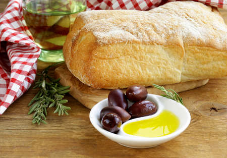 still life in the Italian style - ciabatta bread, olive and oil photo