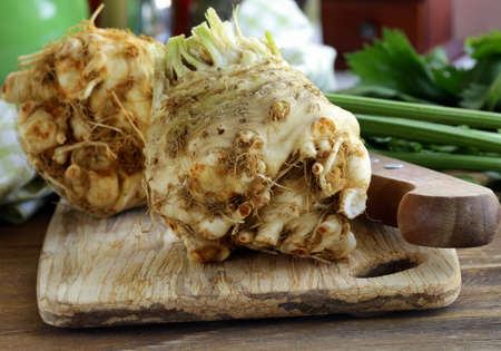 celery root: fresh organic celery root with green leaves Stock Photo