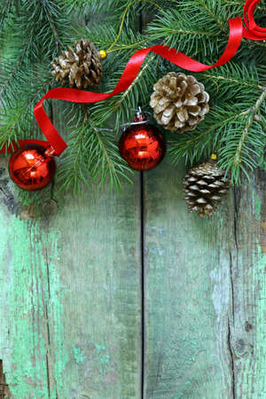Christmas composition with fir twigs and holidays decorations photo