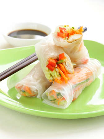 chinese noodles: spring rolls with vegetables and chicken on a plate
