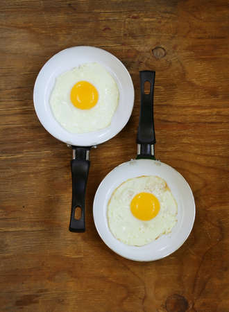 Two pan with fried eggs - breakfast for couples photo