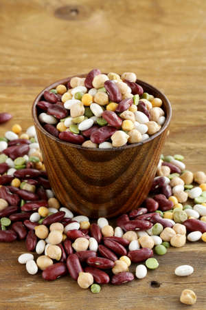 Assortment of different types of beans - red beans, chickpeas, peas photo