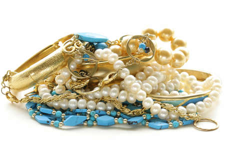 diamond jewellery: gold, turquoise jewelry and pearl,  on a white background
