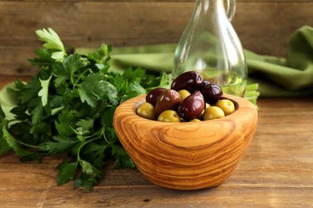 kalamata: marinated green and black olives  Kalamata  in a wooden bowl Stock Photo