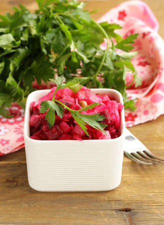 Russian salad with beetroot, cabbage and potatoes photo