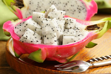 ripe sweet tropical dragon fruit on a wooden plate Stock Photo