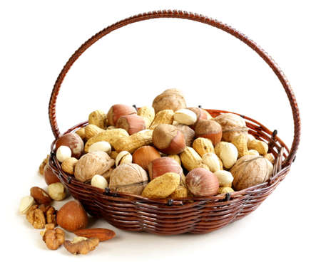 Assortment of different nuts  peanuts, hazelnuts, pistachios, walnuts  photo