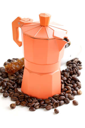 Still life of coffee beans and coffee maker photo