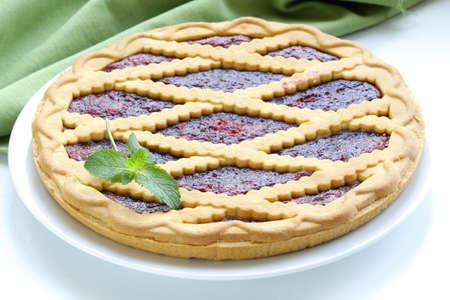 homemade cherry tart of shortcake dough with jam photo