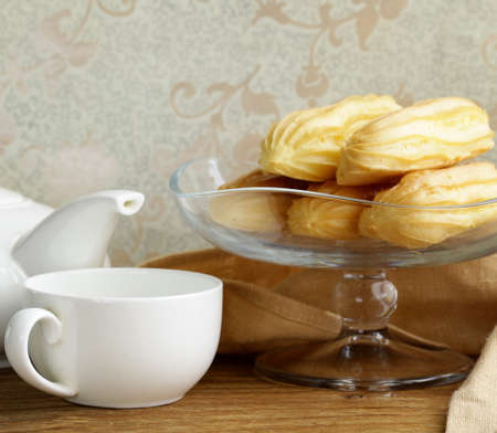 creampuff: choux pastry eclairs on glass stand base, festive dessert Stock Photo