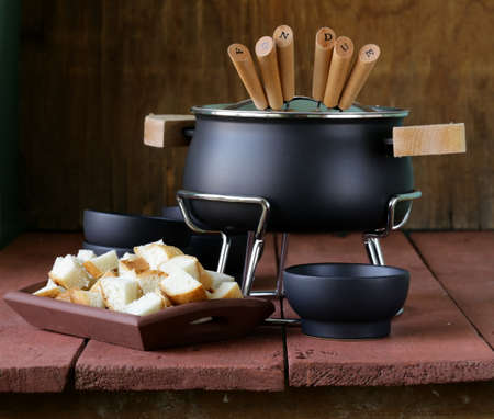 special set of utensils for cooking fondue, cheese and chocolate  photo