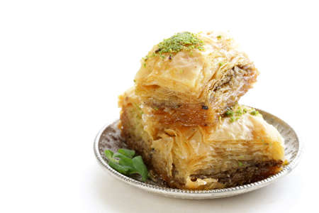 Turkish arabic dessert baklava with honey and nuts on a silver plate Imagens