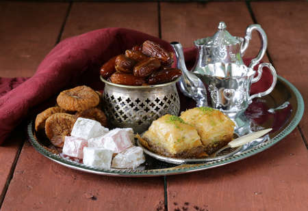 Assorted eastern sweets - baklava, dates, turkish delight photo