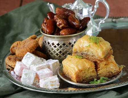 eastern: Assorted eastern sweets - baklava, dates, turkish delight Stock Photo