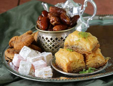 baklava: Assorted eastern sweets - baklava, dates, turkish delight Stock Photo