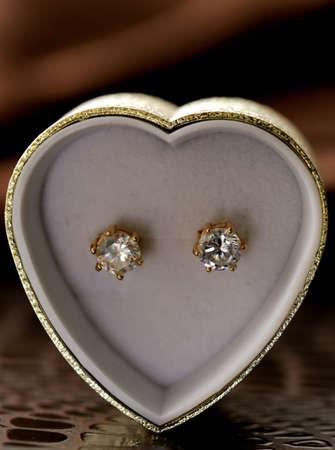 gold earrings stud with diamonds macro shot