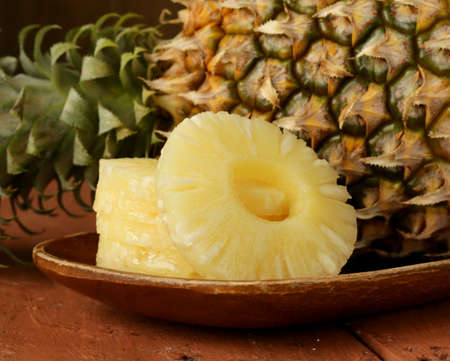 dessert pineapple sliced on a wooden plate photo